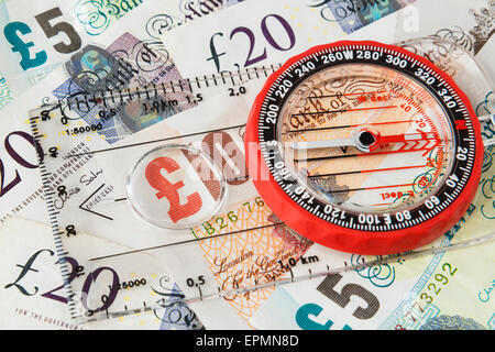 Compass focus on sterling money pound notes to illustrate direction of British economy after Brexit and financial - Stock Photo