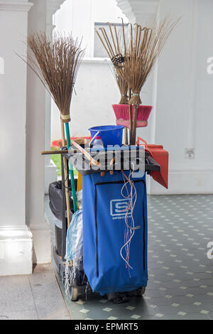 cleaning equipment on the sidewalk in Singapore - Stock Photo