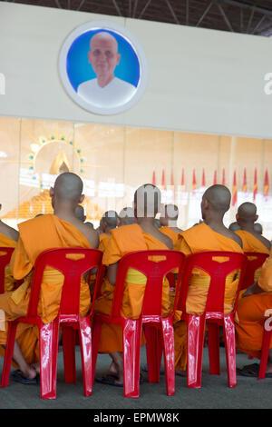 monks pray at the Wat Phra Dhammakaya - Stock Photo