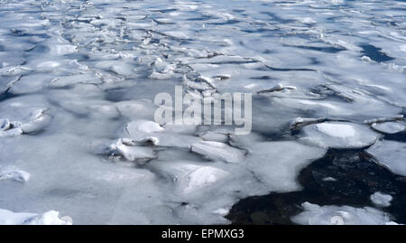 Salt water ice breaking in the late spring on Penobscot Bay at Searsport, Maine - Stock Photo