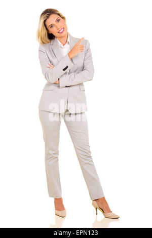 happy young woman pointing empty space isolated on white background - Stock Photo