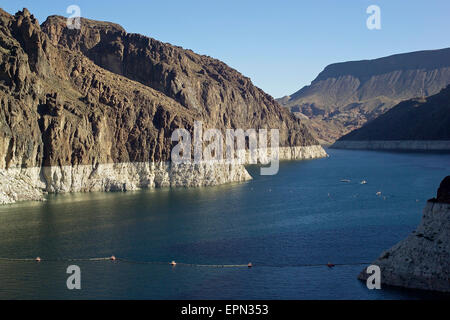 The ongoing drought in the western United States is evident by the lower water line seen on the rock walls that - Stock Photo