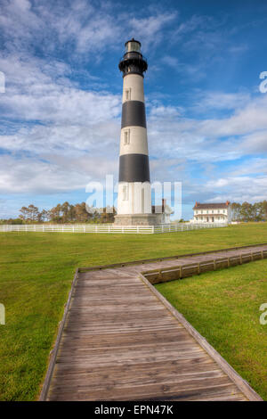 The Bodie Island lighthouse and adjacent boardwalk in Cape Hatteras National Seashore in the Outer Banks of North - Stock Photo
