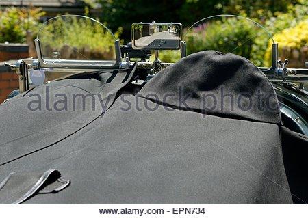 Tonneau cover on a vintage Bentley car. - Stock Photo