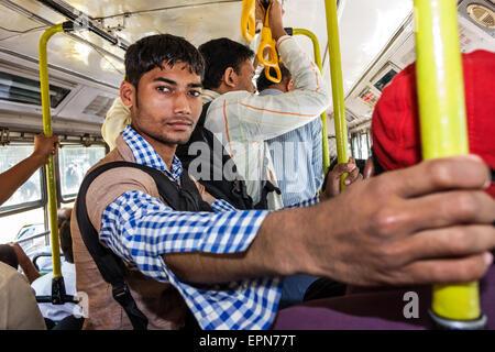Mumbai India Asian Apollo Bandar Colaba BEST bus public transportation inside onboard rider passenger man - Stock Photo