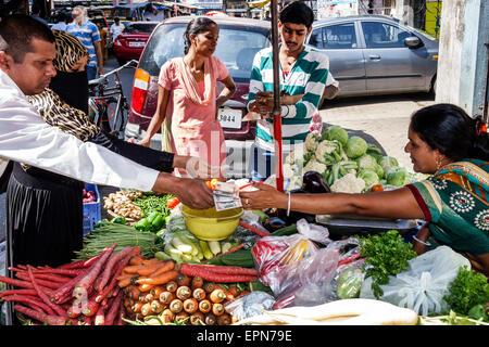 Mumbai India Asian Apollo Bandar Colaba Causeway Market Strand Cinema Road shopping woman street vendor sale display - Stock Photo