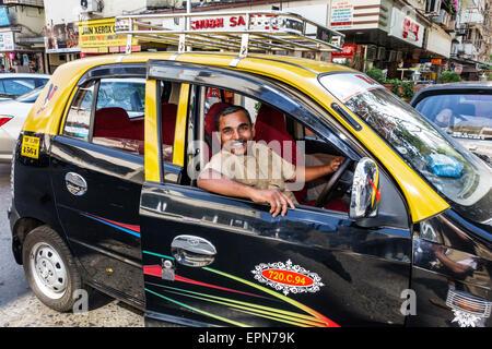 Mumbai India Asian Apollo Bandar Colaba Causeway Market Strand Cinema Road man taxi cab taxis cabs driver job - Stock Photo