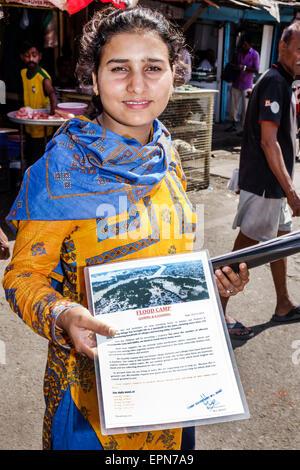 Mumbai India Asian Apollo Bandar Colaba Causeway Market Lala Nigam Road woman seeking donations charity flood disaster - Stock Photo