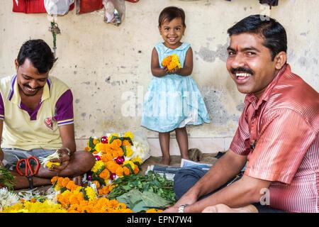 Mumbai India Asian Apollo Bandar Colaba Causeway Market Lala Nigam Road shopping street vendors flower flowers man - Stock Photo