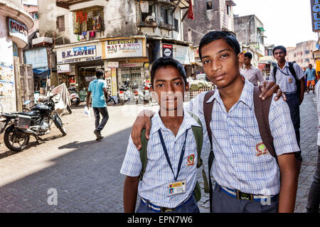 Mumbai India Asian Apollo Bandar Colaba Causeway Market Indumati Sakarikar Marg teen boy friends student school - Stock Photo
