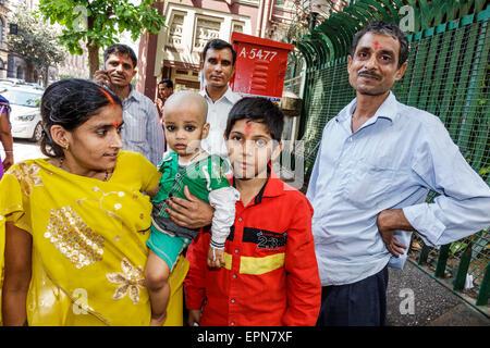 Mumbai India Asian Fort Mumbai Chhatrapati Shivaji Maharaj Marg Hindu woman mother baby boy brother man father family - Stock Photo
