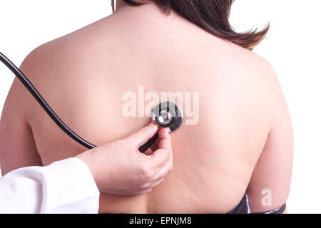 Young woman being investigated for pneumonia by her family doctor . Isolated on white. The picture shows her bare - Stock Photo