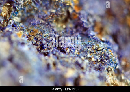 Azurite is a soft, deep blue copper mineral produced by weathering of copper ore deposits with chemical composition - Stock Photo