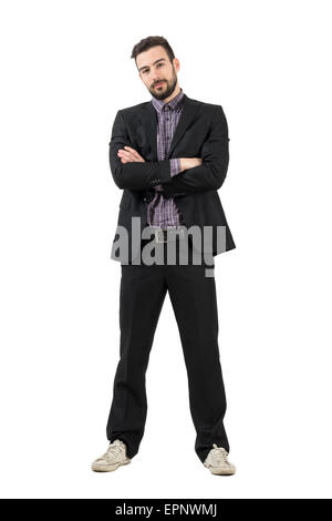 Bearded young trendy businessman in suit and sneakers with crossed arms. Full body length portrait isolated over - Stock Photo