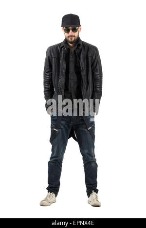 Bearded man in black leather jacket with cap and sunglasses. Full body length portrait isolated over white background. - Stock Photo