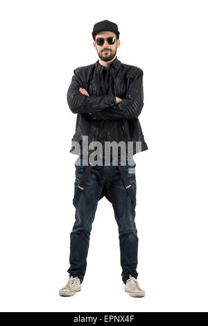 Young bearded man with sunglasses in baseball cap crossed arms. Full body length portrait isolated over white background. - Stock Photo