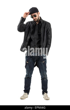 Young bearded man wearing baseball cap, sunglasses in leather jacket. Full body length portrait isolated over white - Stock Photo
