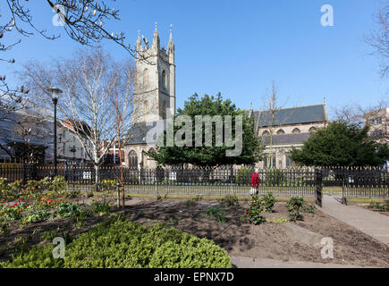 Sunlit Church of St John the Baptist and Churchyard in the Centre of Cardiff - Stock Photo