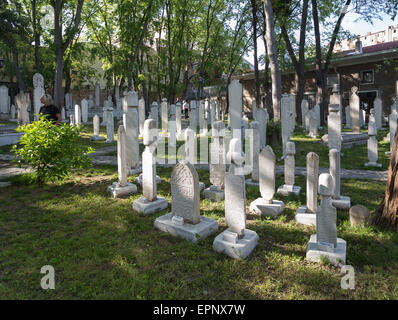 The graveyard inside Galata Dervish House museum in Istanbul Turkey - Stock Photo