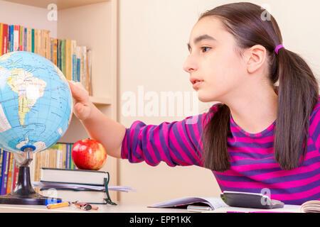 Cute little girl doing homework - Stock Photo