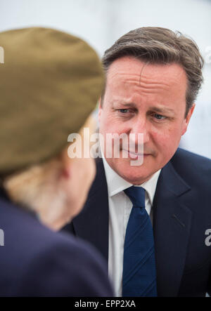 Prime Minister David Cameron speaks to a veteran of World War II during VE day celebrations in London.