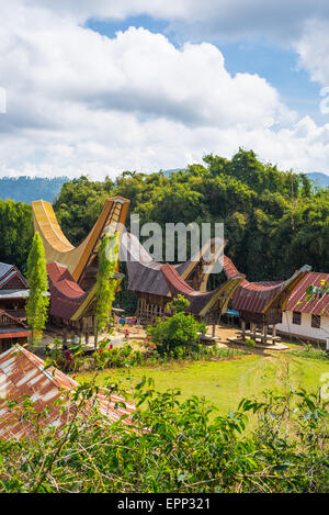Little traditional village with tipical boat shaped roofs in idyllic location among beautiful terraced rice paddies - Stock Photo