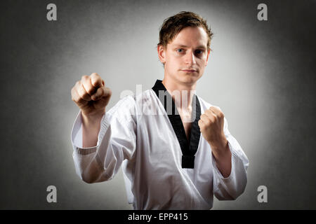 Image of a teakwon do master in self attack position - Stock Photo