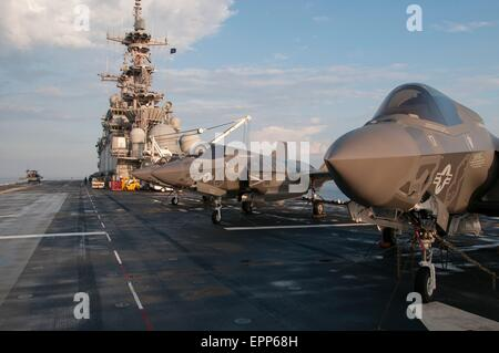 US Marine Corps F-35B Lightning II stealth fighter aircraft secured on the flight deck of the amphibious assault - Stock Photo