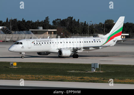 Bulgaria Air Embraer 190 regional jet plane or small airliner taxiing for departure. Commercial aviation and air - Stock Photo