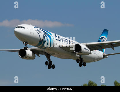 Egyptair Airbus A330-300 widebody passenger jet plane on approach to London Heathrow. Front view closeup. - Stock Photo