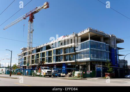 New condominium and retail space building under construction in Vancouver, British Columbia, Canada - Stock Photo