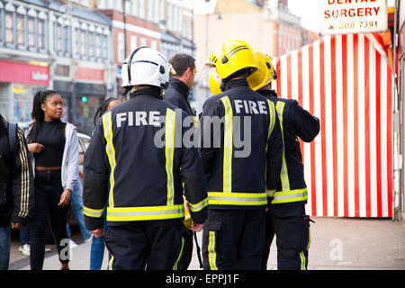 LONDON - APRIL 9TH: The fire brigade attend an emergency in Tottenham on April 9th, 2015 in London, England, UK. - Stock Photo