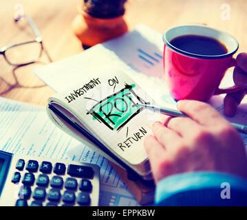 Businessman Notepad Roi Word Concept - Stock Photo