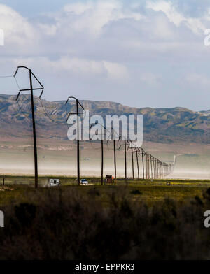 Wires and poles crossing the Carrizo Plain National Monument, California - Stock Photo