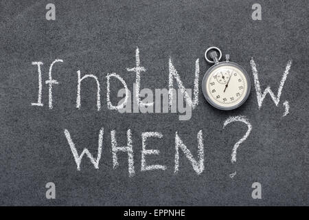 if not now, when question handwritten on chalkboard with vintage precise stopwatch used instead of O - Stock Photo