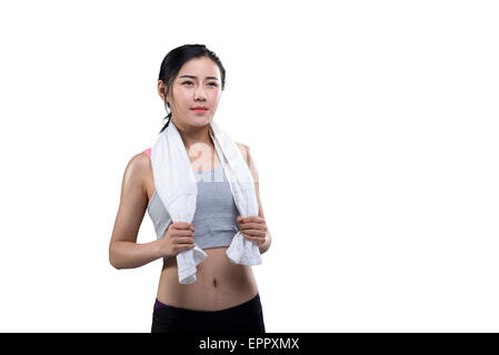 Young female athlete wiping sweat from face - Stock Photo
