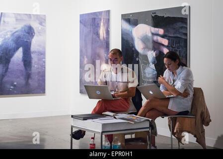 Florida Miami Art Basel international fair exhibition modern contemporary paintings pictures sculptures man girl - Stock Photo