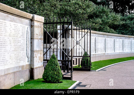 Wall in the peaceful but poignant gardens of American Cemetery, Omaha Beach, Normandy, France inscribed with names - Stock Photo