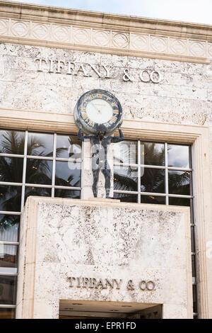 Florida Palm Beach Worth Avenue luxury shopping street road Tiffany & Co jewelry store shop art deco clock figure - Stock Photo