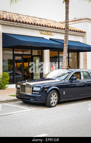 Florida Palm Beach Worth Avenue luxury shopping street dark blue Rolls Royce Brooks Brothers - Stock Photo