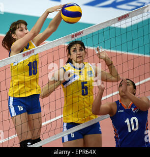 Tianjin, China. 21st May, 2015. Yekaterina Zhdanova (L) of Kazakhstan competes during the group D match against - Stock Photo