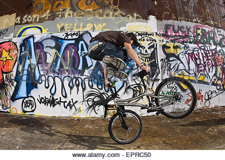 A man doing a trick on a BMX bike in Louisiana. - Stock Photo
