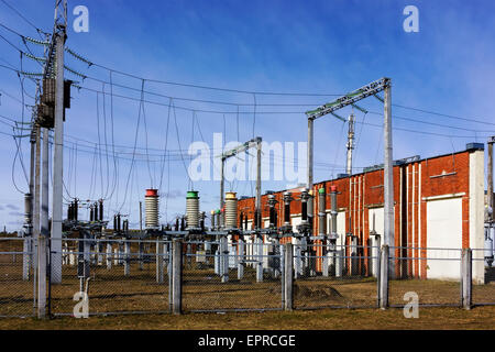 Electric distributive systems and transformers as sunny spring landscape - Stock Photo