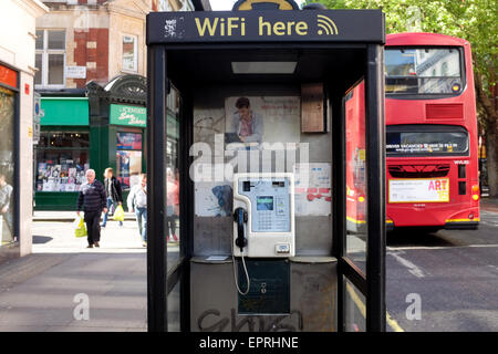 A pay phone in London, England. - Stock Photo