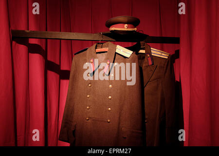 A Soviet military uniform at the former KGB, or 'Cheka' headquarters known by locals as the Corner House in Riga - Stock Photo