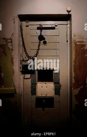 View of the basement prison cells at the former KGB, or 'Cheka' headquarters known by locals as the Corner House - Stock Photo