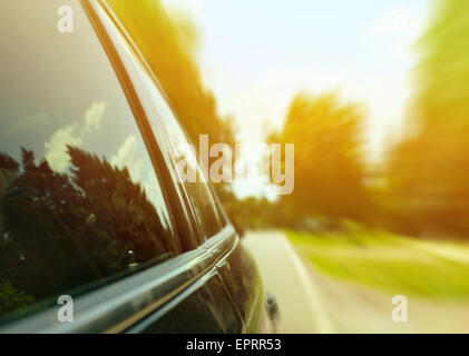 Car driving fast through forest road - Speed concept - Stock Photo