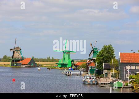 At the Zaanse Schans, Dutch windmills along the river De Zaan north of Amsterdam, the Netherlands. - Stock Photo
