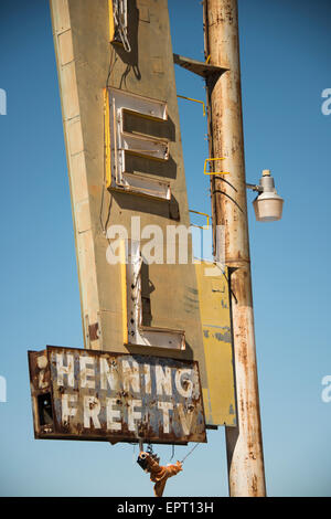 Abandoned rusty motel sign along Route 66 historic road across America in California USA - Stock Photo