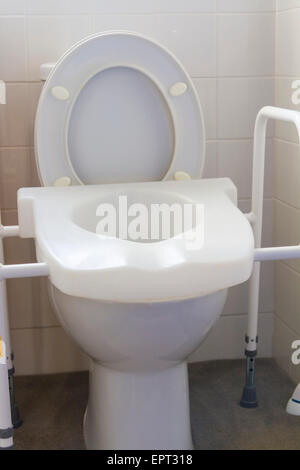 Raised toilet seat and frame for use by people with disabilities - Stock Photo
